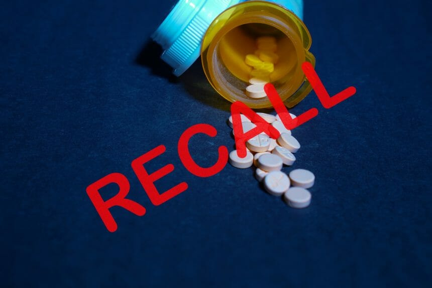 Multiple recalled blood pressure pills laying on the floor