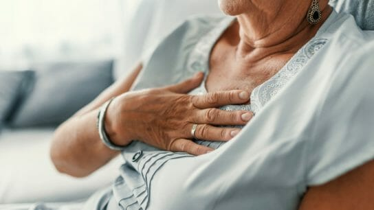 Touching chest in pain