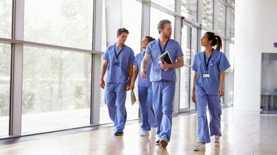 Doctors walking through hospital