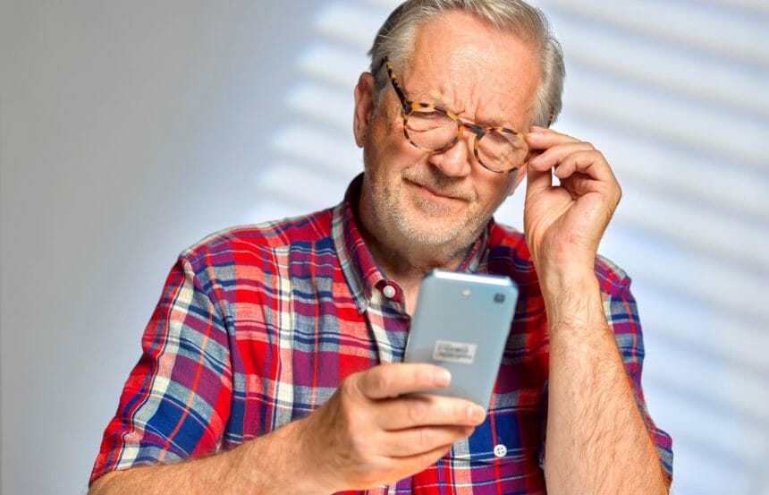 confused senior man with smartphone