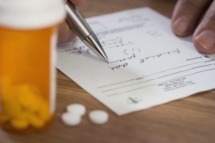 Clinician filling out a prescription